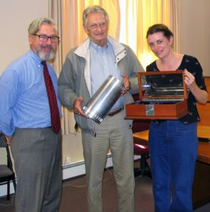 Photo by Roger Gavan On Oct. 21, David Brandt brought a time capsule that he had designed to Village Hall, which he donated for the upcoming Sesquicentennial. From left, Mayor Michael Newhard, David Brandt and Project Coordinator Mary Collura.